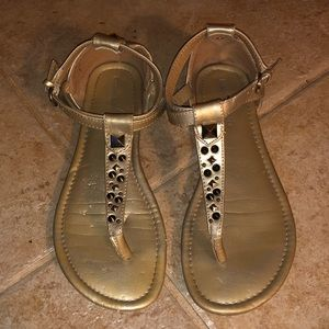 Gold thong sandal.